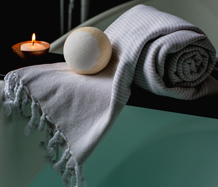 white-and-brown-bath-ball-on-grey-scarf-374032