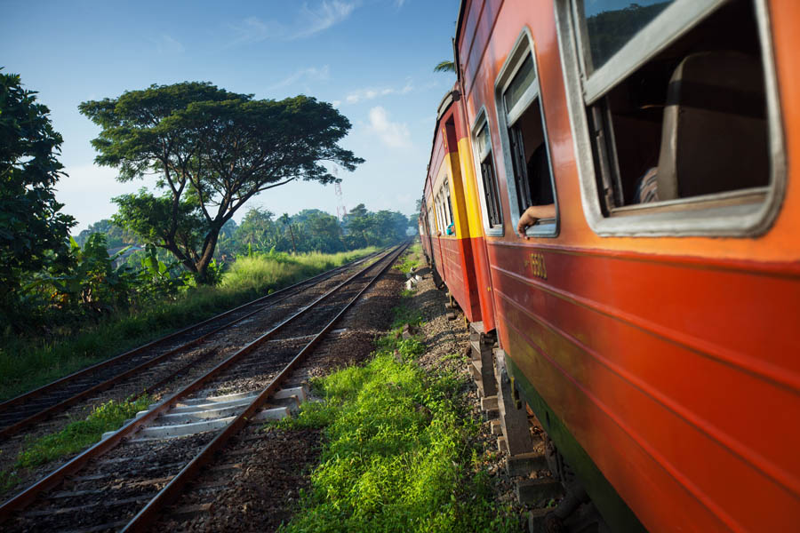 Train moving through coutryside in a sunny day. Sri Lanka